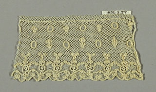 Alençon-style fragment with brides tortillées and minute powdered floral motifs and circles. Lower border design of circles and floral motifs.