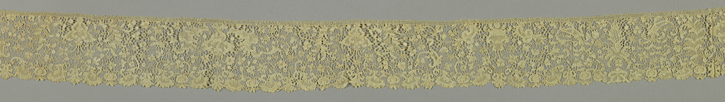Border with elaborate floral arrangements balanced by cartouche forms and volutes.