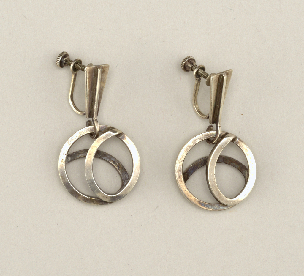 Pair of pendant earrings with openwork circular decoration; screwback mounts.