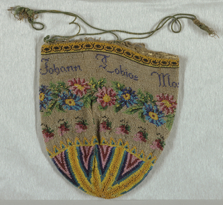 Bag of beaded knitting with leather lining. Beads worked in triangular patterns at bottom; main field has floral garlands encircling the bag with inscription: Johann Tobias Marzius 1821.