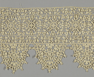 Deeply scalloped border with a horizontal band of circular ornaments within squares.