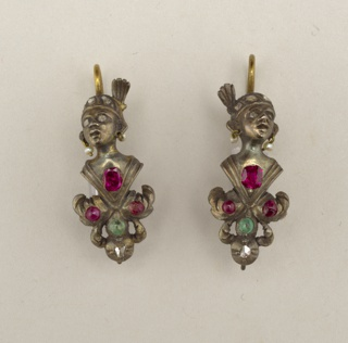 A and B: Gilt earrings in the form of a human head wearing a turban set with paste diamonds and pearl earrings; at the bottom, a leaf ornament set with red and green stones.  RIng at bottom indicates a part may be missing.