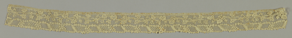 """Needle lace with a design of twisting vines and grapes. Commonly called """"Point d'Argentan"""""""