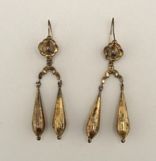 Each consists of two parts.  A) and B) are upper parts, faced with convex pear shape and scalloped edge; designed for pierced ears.
