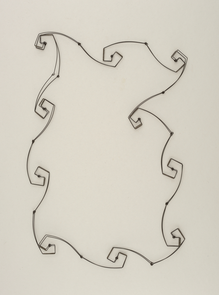 Necklace or choker in shape of star with curled points.