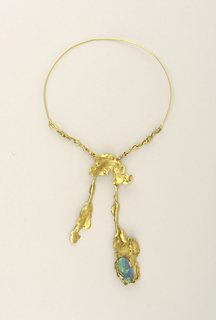 Choker (b) of plain gold at the back; at the front, flattened bits and pieces--as though melting--gold supporting an oval blue opal (a).