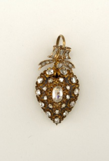 Pendant (a) pear shaped; gold partially enameled, set with 21 cut diamonds; suspended from loop and hook (b) in the form of ribbon bow, set with glass insert (c) on back of pendant to form locket.