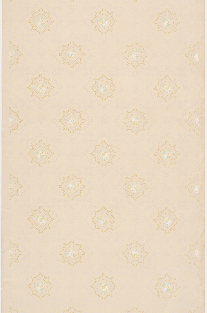 Alternating rows of scalloped medallions contain rose blossoms within circular dotted border. Pattern is printed in white, green and metallic gold on tan ground.