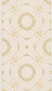 Round medallions are framed by concentric rings of dots, horizontal hatching and floral garlands. Laurel wreaths extend from four evenly spaced points around the floral garland. Medallions are positioned in the center of large, scrollwork quatrefoils with acanthus detailing. Pattern printed in beige, olive green, and tan on light beige ground.