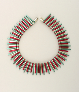 Necklace made from green, red and silver anodized aluminum cotter pins.