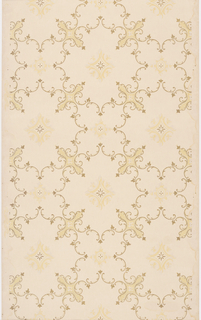 Rococo inspired foliate scrolls are embellished with small trefoil leaves and create an alternating pattern of large and small quatrefoil cells. Larger cells contain eight-petal starburst form, smaller cells contain four-petal starburst form. Starbursts are further embellished by faint foliate border. Paper is printed with light pink and beige, scrolls and starbursts printed in metallic gold.