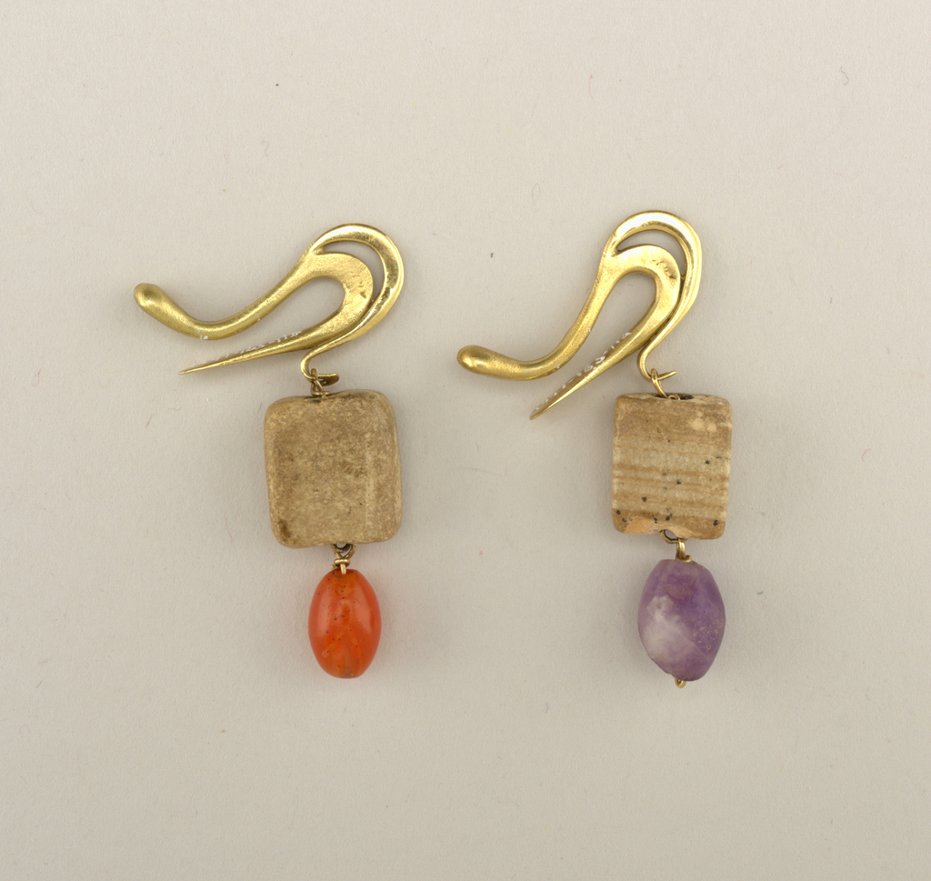 Gold clasps in shape of beak-like profile with pendant beads.