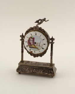 Rocaille pedestal with repousse foliage motifs; supports and flowers surrounding circular case in style of seventeenth century. Enamelled dial, with seascape, applied to a watch