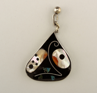 Teardrop shaped, inlaid on black enamel background with irregular-shaped pieces of mother-of-pearl, silver, blue stone, and on the back side with orange stone; 3-section link on hook with ball finial attached at top.