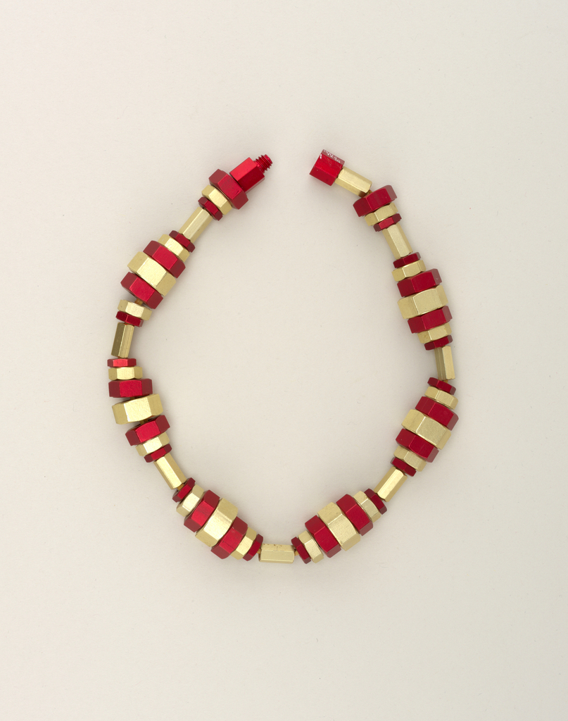 Necklace made from red and and gold anodized aluminum nuts.