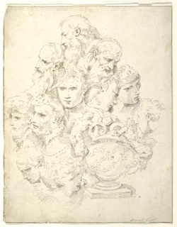 Eleven heads, of varied figures, and an urn decorated with sculpted garlands and handles composed of satyrs and snakes.