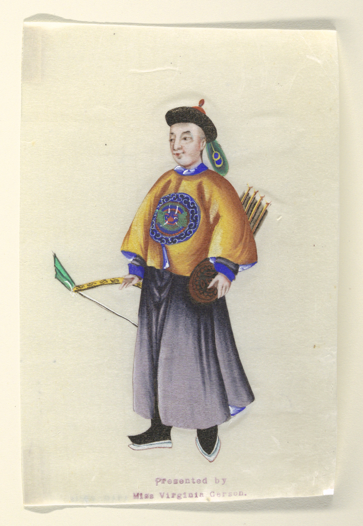A standing man, facing one-quarter left, wearing a small black hat trimmed with a peacock feather, and carrying bows and arrow.s