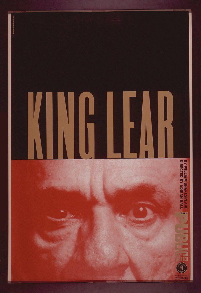 """Upper half of poster has black ground and gold text: KING LEAR. The bottom half of the poster shows a red-printed photographic image of a close-up of the top of a man's face, focusing on his intense gaze and seering, perhaps wrathful, expression of his eyes.  The letters of the title """"King Lear"""" are like a crown on the man's head."""