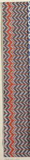 Chevron pattern in shades of gray and red.