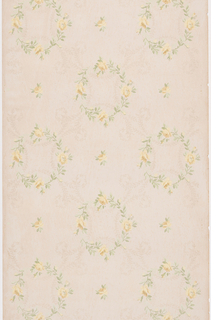 Rows of alternating circular, floral wreaths and individual blossoms, possibly roses, are printed atop a faint pattern trellis pattern created by thin, leafy branches. Design is printed in yellow, green and beige on tan ground.
