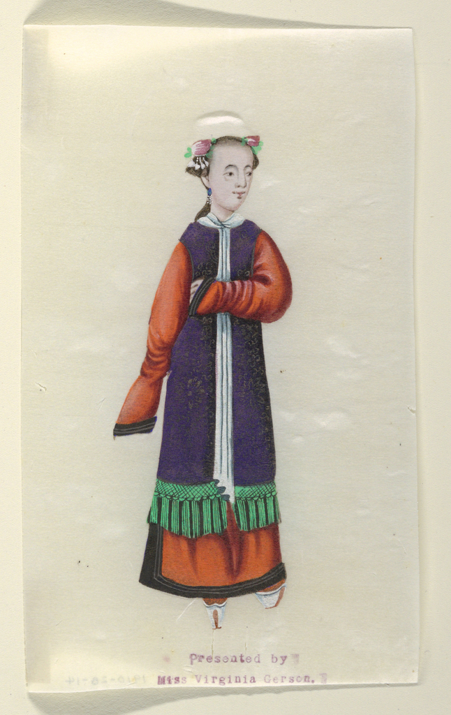 A standing lady, seen frontally, wearing a blue smock over an orange undergarment.. She holds her right hand at her breast.
