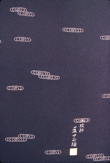"""Stenciled paste resist (komon) scarf with a pattern of very fine stripes. The stencil is  called """"shima-bori"""" (stripe cutting). Background color chages from a fine green and white stripe to a lavender and white stripe.   Back is a solid black with resist dots and Mr. Aida's signature in Japanese characters."""