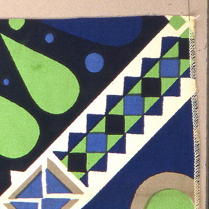 Geometric shapes with tear drops are printed in blue, green, grey and black.