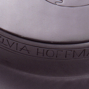"""Circular form, lid engraved with stylized, veiled ancient Greek female head in profile.  Side of lid engraved in banner-like cartouche: """"Sylvia Hoffman 1938"""". (Set with 1998-21-1,2)"""