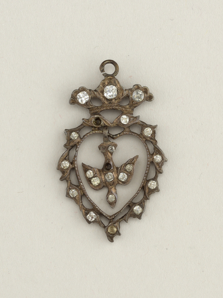 Figure of dove inside a silver heart, surrounded by paste diamonds.