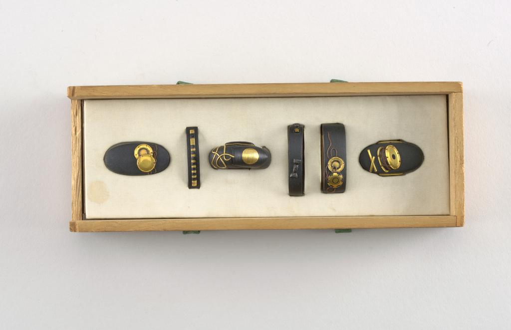 black sheath pieces w/ drum and cymbal motifs.