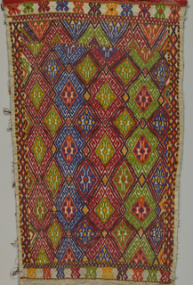 Rectangular panel with lozenge design surrounded by narrow borders. Colors: red, green, blue, orange, brown, and yellow.