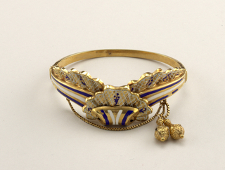 Hinged bracelet with clasp; design of scroll and lace frills; fine chain with two gold pendants.