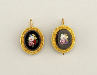 Design of flowers in mosaic, set in onyx and mounted in a gold frame.