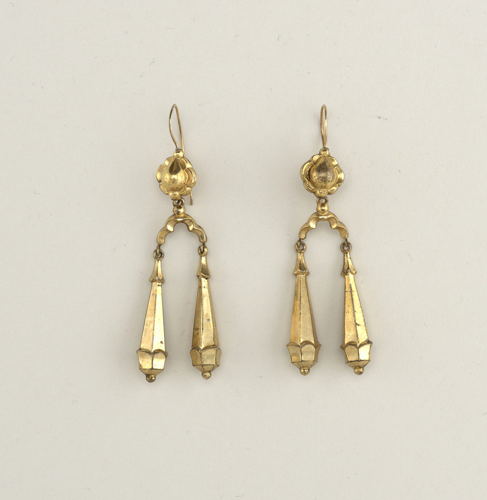 Earrings in design of rosette with two cone-shaped six-sided pendants.