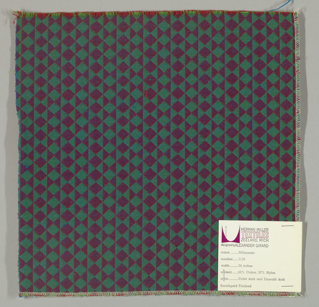 Double cloth in a magenta and green striped pattern of diamonds and triangles. The warp threads are green and red and the weft threads are turquoise and blue. The red warp and blue weft intersect and appear as magenta while the green warp and turquoise weft intersect and appear as bright green.