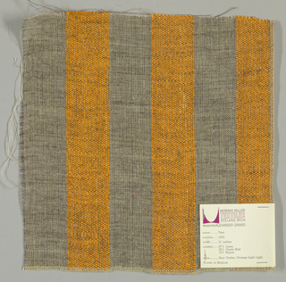 Plain weave of variegated grey and orange wide vertical stripes. The grey striped areas are comprised off-white warps while the wefts are comprised of white threads loosely twisted with black goat hair. The orange stripes are made of heavier warp threads with a slight sheen.