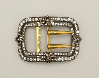 Rectangular buckle with rounded corners; design of a double row of citrines held together in four places by bow knots; prongs and fastener made of brass.