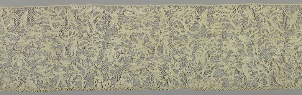 Flounce with a design of huntsmen, birds, animals, and elaborate tree pattern. Pattern pieces connected by large scale four-sided mesh.