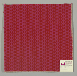 Double cloth in a red and pink striped pattern of diamonds and triangles. Red and pink warps and red and pink wefts intersect to made solid areas of color in the pattern.