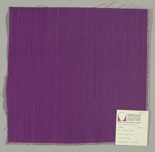 Plain-woven cotton in purple. Slight variations in the color of the warp threads give a subtle stripe effect.