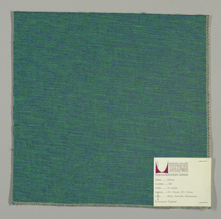Weft-faced plain weave in blue, green and black. The blue and green weft threads give the predominant color. There are black warp threads which appear on the surface. A black binding warp is visible on the reverse.