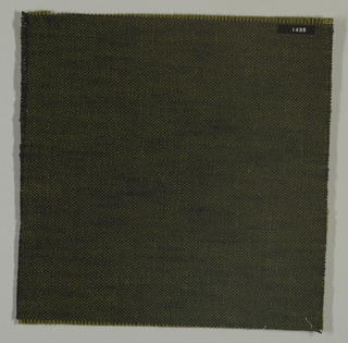 Plain weave with olive green warp and black weft. Heavy nylon yarns give a coarse surface texture.