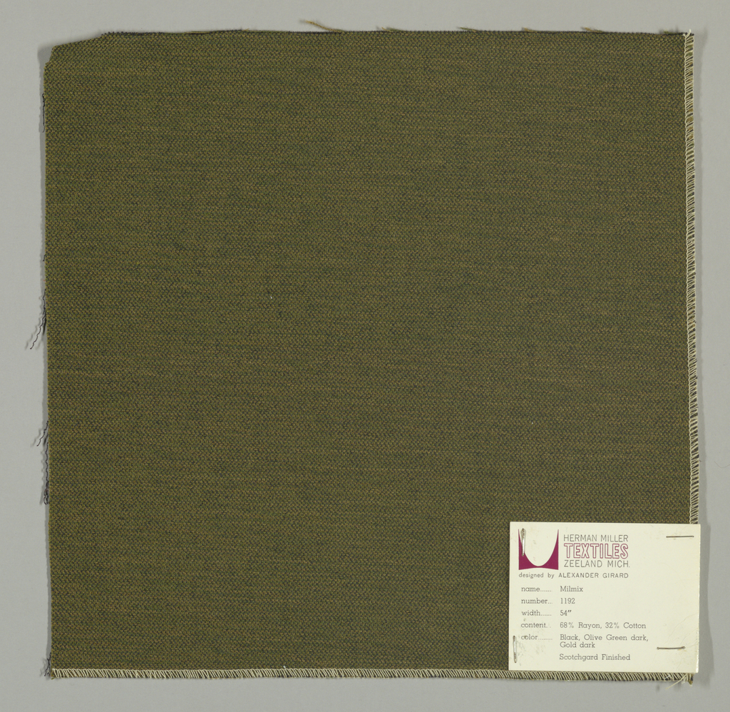 Weft-faced plain weave in olive green, gold and black. The olive green and gold weft threads give the predominant color. There are black warp threads which appear on the surface. A black binding warp is visible on the reverse.