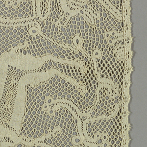 Design shows column with birds, stags and scrolling leaves. Narrow bobbin lace surrounds panel on four sides.