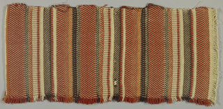 Upholstery fabric with horizontal stripes of rust, brown, ivory, and copper Lurex in varying twill effects.