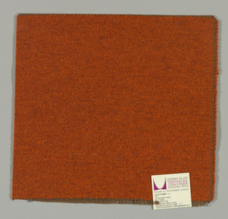 Weft-faced plain weave in red-orange with a plain weave foundation. Weft-facing yarns are coarse and loosely twisted. Foundation weave consists of brown warp threads and dark brown weft threads.
