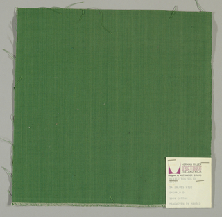Plain-woven cotton in dark green. Slight variations in the color of the warp threads give a subtle stripe effect.
