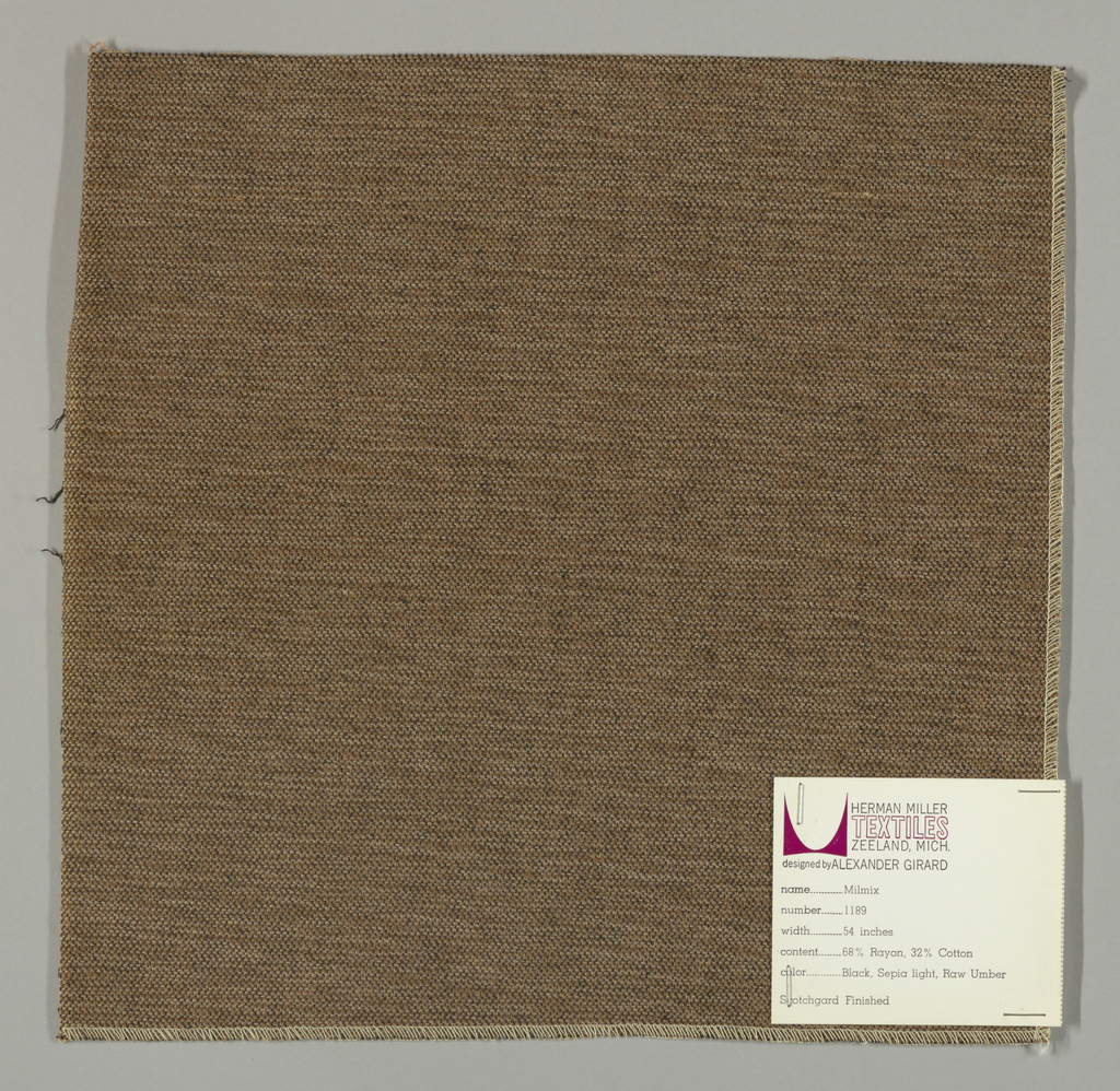 Weft-faced plain weave in light brown, brown and black. The light brown and brown weft threads give the predominant color. There are black warp threads which appear on the surface. A black binding warp is visible on the reverse. .