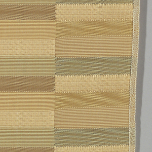 Vertical bands comprised of narrow horizontal rectangles in light gray, pale pink and pale gold. Weft threads are teal, light brown and gold while the warp threads are white. Changes in the weave structure make subtle color differences apparent on the surface.