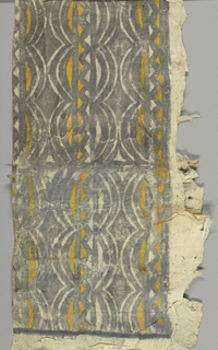 Two thicknesses of bark cloth, white, printed in grey and yellow in lozenge and zigzag pattern.